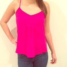 Pink tank top Bright pink tank top from Forever 21!  Perfect for going out or with a sweater to work. Size small. Forever 21 Tops Tank Tops