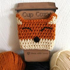 Keep your hands from burning and add something extra to any drink with this adorable crochet fox cup cozy! Works great at keeping your hands from freezing on cold drinks too! Fits any standard sized take out cup and also fits well on travel mugs. This adorable little guy is handmade with very soft, acrylic yarn, and each face is stitched on by me. If you love foxes as much as me, have a look at my other fox items: https://www.etsy.com/listing/485292253/the-happiest-f...