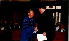 President Campbell giving out awards for graduation, 1990s :: Staubitz Archives Digital Images