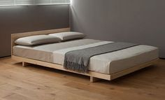Kobe Low Wooden Bed dressed with our 400 thread count Egyptian cotton bedding. All from Natural Bed Company