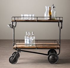 Inspired by a vintage factory trolley, this bar cart from Restoration Hardware adds the perfect touch to any man cave.