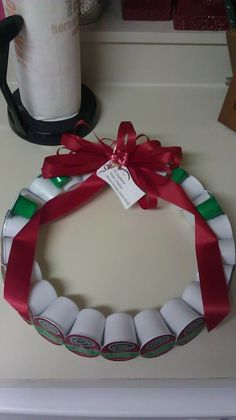 K-Cup wreath for Keurig. Holiday flavors and irish cream creamers attached (green).