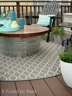 """bucket table for the deck.  you can store all the stuff in the table that you don't want to leave out in case it rains (citronella candles, pillows, etc.), then just grab it out whenever."""