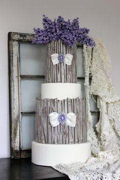 Rustic shabby wedding cake with wood grain and lilacs