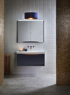 Blue mirrored bathroom cabinet from Utopia Bathrooms.