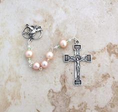 Reginas Catholic Gifts - Sterling Silver Pink Freshwater Pearl Rosary, $199.99 (http://www.reginascatholicgifts.com/sterling-silver-pink-freshwater-pearl-rosary/)