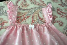 Little girls dress or nightie! This is almost exactly how I make my girls' quickie antique pillowcase nightgowns. Elastic on the front and back with deep armholes & flutter sleeve straps.  Sew cute & comfy!