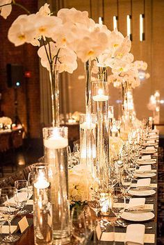 wedding centerpieces tall with white orchids and roses colin miller photography