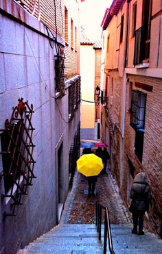 I took this photo when I was on a day trip Toledo, #Spain few years ago on my round the world trip. I never noticed this photo till years later when I scrolled past this photo but was truck by the bright yellow umbrella. I love the windy roads of the old quarter. If you're heading to Madrid, it's an easy bus ride there and back. #wanderlust #travel #daytrip