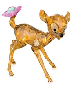 Swarovski Bambi pays tribute to this world famous character. With his Topaz crystal body with Silver Shade coating and a cute butterfly in Rose crystal on his tail, Bambi bring joy to Disney fans and collectors alike. Glass Figurines, Collectible Figurines, Swarovski Crystal Figurines, Swarovski Crystals, Figurine Disney, Disney Home Decor, Crystal Collection, Disney Merchandise, Disney Art