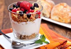 Low carb healthy breakfast for a boost / yogurt with muesli and berries in small glass
