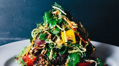 This is no simple salad: It's a multicourse meal on a plate. Its dramatic presentation is part of the allure.