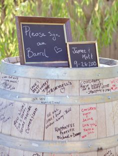 """A """"sign the barrel"""" guest book. Unique idea for a country wedding."""