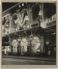 """Her Majesty's Theatre, Sydney, decorated and illuminated for the visit of the Prince of Wales and showing """"Kissing time"""", 1920 / photographer unknown by State Library of New South Wales collection, via Flickr"""