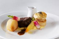 Seared fillet of beef and little puff pastry topped tart of pot roasted pulled brisket, served with sesame roasted and herby creamed parsnip and  horseradish spiced jus - by Heritage Portfolio