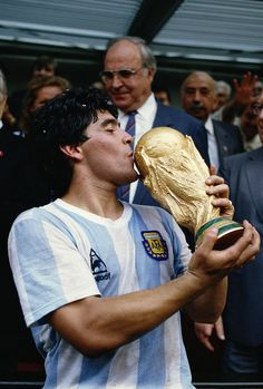 29 Jul Diego Maradona of Argentina kisses the trophy after the World Cup final against West Germany at the Azteca Stadium in Mexico City. Argentina won the match Mandatory Credit: Mike King/Allsport Argentina Team, Argentina World Cup, Maradona Tattoo, Diego Armando, Cup Tattoo, Legends Football, Football Images, Women's Cycling Jersey, Cycling Jerseys