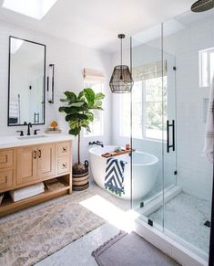 No matter your aesthetic, black hardware never fails to define a design while adding a hint of contemporary edge. It's particularly striking when used as a contrast in bright and breezy spaces like this one. Learn how to recreate this home. #hunkerhome #bathroom #bathroominspo #bathroomideas #bathroomdecor