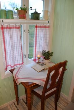"""This is a reminder to find my table cloths like this, get them out and use them. I think I have the perfect spot at a window upstairs in the """"craft kitchen"""". The website this comes from is in Swedish, but the photos show how she created the little ledge and hung the curtain rod at the window, and how she did the tabs on curtain. There are also some other lovely little photos there that I want to go back and study one of these evenings."""