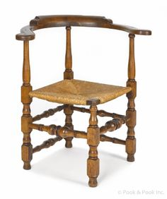 New England William & Mary roundabout chair, ca. 1750, with boldly turned baluster and block legs and stretchers. The William and Mary style (or Baroque) of furniture was popular from 1690-1730. This style is an American variation of the Baroque style popular in Europe earlier in the 1600s. William and Mary style pieces filled a demand for furniture providing both comfort and luxury.  Turned legs were fashioned with chisels or other tools while being spun on a lathe. This made them…