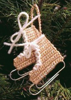 Christmas Crochet: Miniature Ice Skates  Gonna try to make these so my daughters stop fighting over who gets to throw them on the tree!