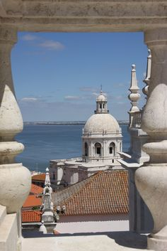 Seen from the roof top of the São Vicente de Fora Monastery (built in 1582) towards the Santa Engracia Church, Portugal's National Pantheon, and the Tagus river estuary.