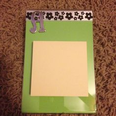 Acrylic frame, scrapbook paper, ribbon, simple chipboard letters and sticky notes!