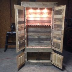 Gun cabinet made from pallets. Could use chicken wire on the doors and add more shelves for a display case.