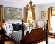 The bed in the master bedroom belonged to Currie's grandfather and is dressed in linens by Matouk and cashmere pillows by Ralph Lauren Home; the painting above it was found at an antiques show in East Hampton. The walls are painted in Blue Glow by Pratt & Lambert Paints, the burlap curtains are trimmed with grosgrain ribbon, and the chandelier was found in Paris.