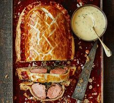 A twist on the classic beef Wellington with a succulent fillet of pork and a rich mustard and cream sauce. Treat yourself to the ultimate posh sausage roll