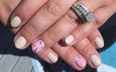 Beautiful white gel polish nails with a stunning pink sparkly accent nail. Created by Nikki! colorsbykim.com