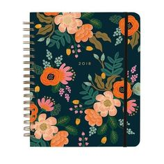 The Rifle Paper Company 17-month spiral bound planners feature an exposed spiral binding, gold foil accents, elastic closure, a pocket folder with ruler and met