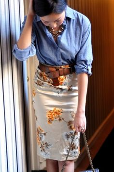Floral skirt belted plus a tucked jean shirt. Flower patterned business attire #businesscasual #casual #businessattire #businessclothes #fallclothes #workclothes #professionalattire #businessfashion #professionalfashion #style #fashion #clothes #work #professional #business #
