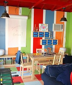 Like the bright stripes & paper roll (Gia Russo's Real Simple Playroom Makeover) Boys Bedroom Paint, Kids Room Paint, Playroom Organization, Playroom Ideas, Daycare Ideas, Basement Ideas, Nursery Ideas, Organization Ideas, Storage Ideas