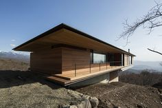 Wonderful Wooden Deck With Simply Fence Design Towards The Entrance Door Along With The Wooden And Glass Wall Exterior Of The Minimalist House Minimalist House on the Slope Demonstrates Breathtaking Views Home design