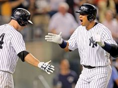 A-Rod goes deep -  Alex Rodriguez (right) of the New York Yankees celebrates his grand slam with teammate Brian McCann during a game against the Minnesota Twins on Aug. 18 at Yankee Stadium in New York City. The hit extended his major league record for grand slams to 25 and helped the Yankees win 8-4. - © Elsa/Getty Images