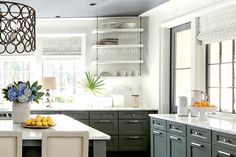 Kitchen: The Decorating - Palmetto Bluff Idea House Photo Tour - Southernliving. Simple Shaker-style cabinets in a gray-blue shade (Winslow in Willow