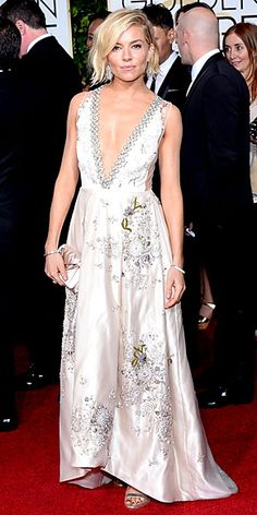 """{SIENNA MILLER """"I tried on a few, but this one was the one,"""" the actress said of her deep V-neck, embroidered Miu Miu satin gown with sheer sides, which she wore with Tiffany & Co. jewels. We were torn about whether it was a winner in the end, but one thing's for sure: Her tousled bob is making us want to cut our hair short, like, now.}"""