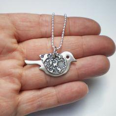 Silver bird pendant by AliBaliJewellery from the UK