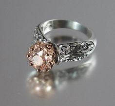 The ENCHANTED PRINCESS engagement ring in silver and Morganite by WingedLion, $920.00.  Pair with a rose gold wedding band?