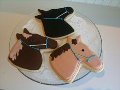 Beautifully decorated horse head sugar cookies w/ royal icing