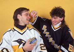 Czech professional hockey player Jaromir Jagr of the Pittsburgh Penguins pretends to feed sardines to his teammate Canadian Luc Robitaille, February (Photo by Bruce Bennett Studios/Getty Images) Bruce Bennett, Hockey News, Hockey Boards, Sports Personality, New Jersey Devils, National Hockey League, Pittsburgh Penguins, Hockey Players, Ice Hockey