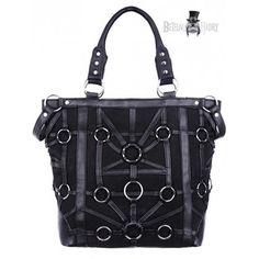 Dámská kabelka je  zdobena koženými pruhy propojenými O - kroužky, má velkou kapsu na zi a dvě malé, možnost nosit přes rameno.