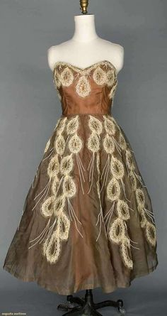augustaauctions:  Gorgeous 1955 Organdy Evening Gown from England. Taupe, strapless, trimmed in white beads & horsehair, straw & seq...
