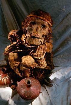 Wari mummy and vessels,Empires of the Sun; Peru; Wari; Huari, National Museum of Peru