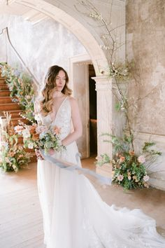 Warm, Whimsical Florals Throughout an Abandoned Manor Perfectly Compliment This Bride's Natural Beauty #naturalbrides #elegantbridalinspiration