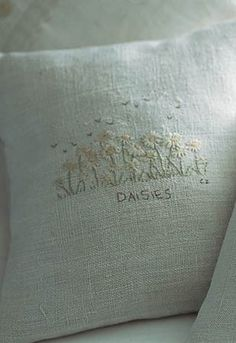 HAND-EMBROIDERED 'DAISIES' cushion by Caroline Zoob
