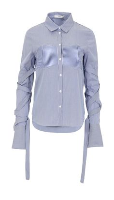 This menswear-inspired button-down shirt in crisp cotton poplin features removable sleeve straps a striped bodice panel. Give yours a contemporary feel with a half tuck into trousers or tailored denim.    Styled with Denim Slouch Pants  100% Cotton. Professional Dry Clean Only.  Style Number: TR216MSS74774  Available in: Blue Stripe