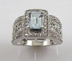 <314K white-gold ring with about 20 accent diamonds and a large center aquamarine