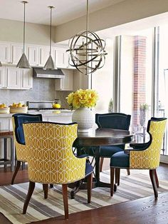 Great pop of yellow and navy in the chairs - nice contrast with the mostly white kitchen.