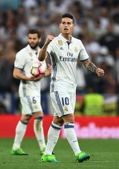 James Rodriguez of Real Madrid celebrates as he scores their second goal during the La Liga match between Real Madrid CF and FC Barcelona at Estadio Bernabeu on April 23, 2017 in Madrid, Spain.